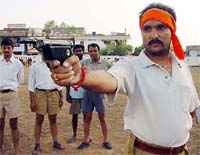 A Hindu extremist practising weaponing at a Bajrang Dal training camp